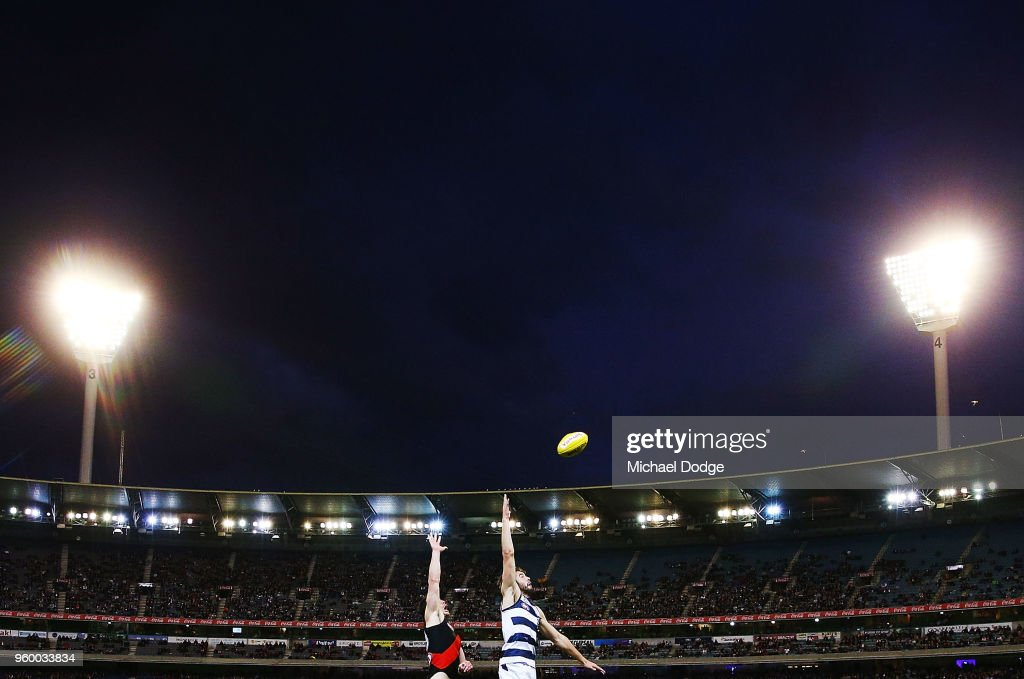 Conor McKenna of the Bombers (L) and James Parsons of the Cats compete for the ball during the round nine AFL match between the Essendon Bombers and the Geelong Cats at Melbourne Cricket Ground on May 19, 2018 in Melbourne, Australia.