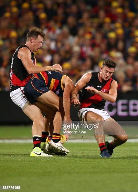 Conor McKenna of the Bombers bumps Riley Knight of the Crows during the round four AFL match between the Adelaide Crows and the Essendon Bombers at...