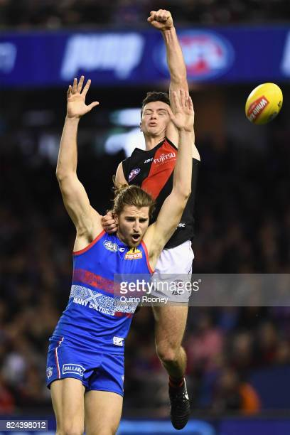 Conor McKenna of the Bombers gives away a free kick against Marcus Bontempelli of the Bulldogs during the round 19 AFL match between the Western...