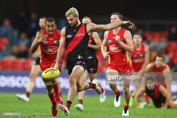 Conor McKenna of the Bombers kicks during the round 11 AFL match between the Gold Coast Suns and the Essendon Bombers at Metricon Stadium on August...