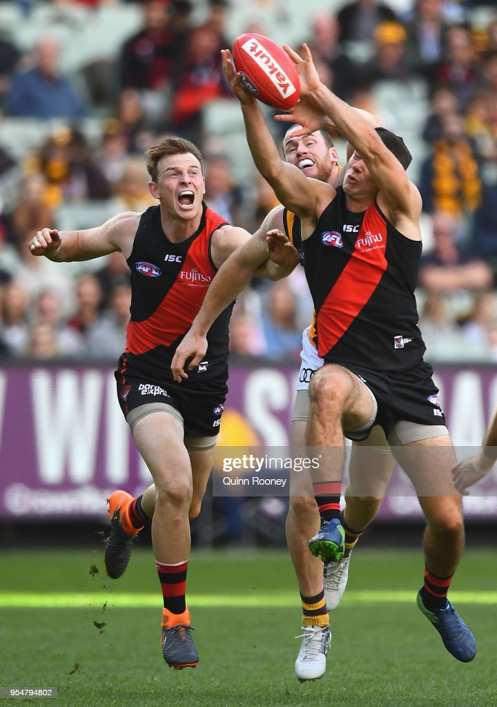 Conor McKenna of the Bombers marks infront of Jarryd Roughead of the Hawks during the round seven AFL match between the Essendon Bombers and the Hawthorn Hawks at Melbourne Cricket Ground on May 5, 2018 in Melbourne, Australia.