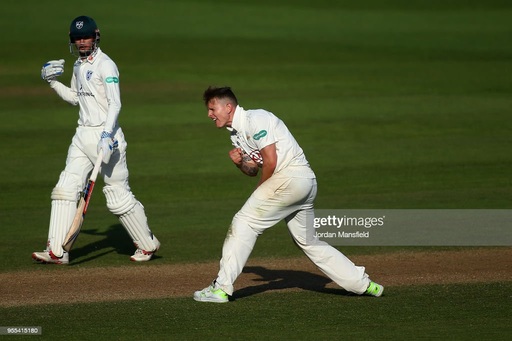 Conor McKerr of Surrey celebrates dismissing Joe Clarke of Worcestershire during day three of the Specsavers County Championship Division One match between Surrey and Worcestershire at The Kia Oval on May 6, 2018 in London, England.