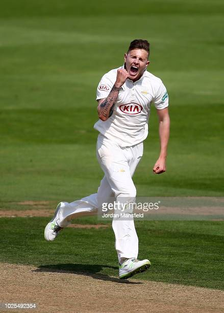 Conor McKerr of Surrey celebrates dismissing Riki Wessels of Nottinghamshire during day three of the Specsavers County Championship Division One...