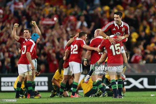 Conor Murray and Leigh Halfpenny of the Lions celebrate victory in the International Test match between the Australian Wallabies and British Irish...