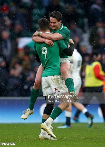 Conor Murray of Ireland and Joey Carbery of Ireland celebrate victory after the NatWest Six Nations match between England and Ireland at Twickenham...