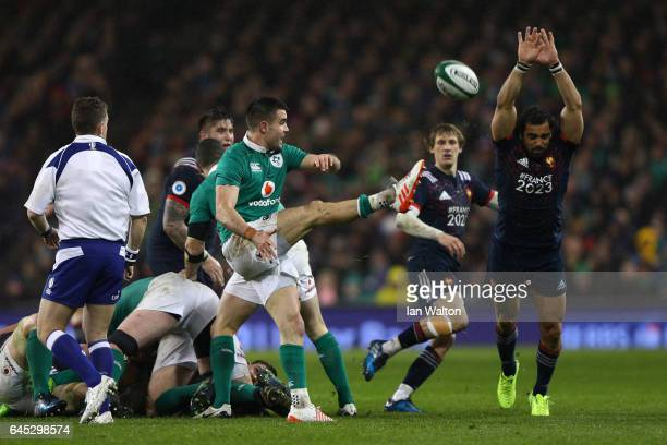 Conor Murray of Ireland clears the ball under pressure from Yoann Huget of France during the RBS Six Nations match between Ireland and France at the...