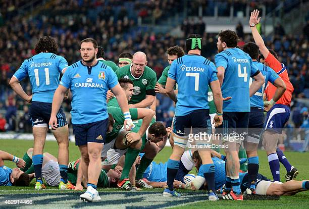 Conor Murray of Ireland is congratulated by teammate Paul O'Connell of Ireland after burrowing over the line to score his team's first try during the...