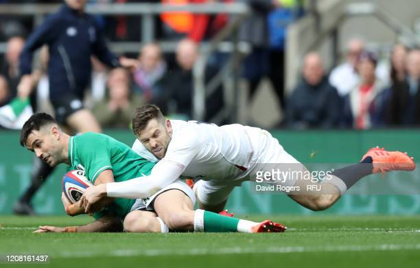 Conor Murray of Ireland is tackled by Elliot Daly of England during the 2020 Guinness Six Nations match between England and Ireland at Twickenham...