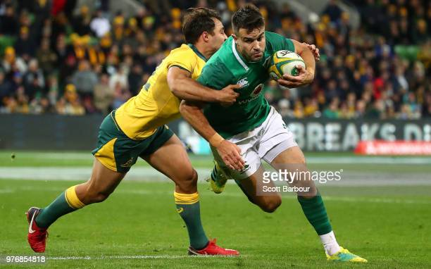 Conor Murray of Ireland is tackled by Nick Phipps of the Wallabies during the International test match between the Australian Wallabies and Ireland...