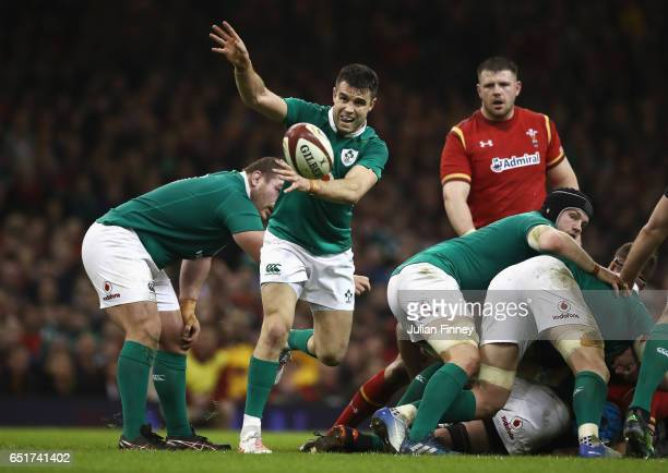 Conor Murray of Ireland passes the ball out during the Six Nations match between Wales and Ireland at the Principality Stadium on March 10 2017 in...