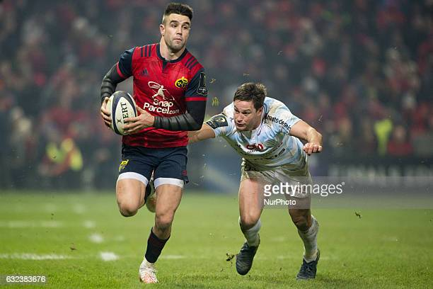 Conor Murray of Munster runs with the ball during the European Rugby Champions Cup Round 6 match between Munster Rugby and Racing 92 at Thomond Park...