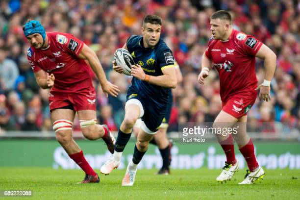 Conor Murray of Munster runs with the ball during the Guinness PRO12 Final between Munster Rugby and Scarlets at Aviva Stadium in Dublin Ireland on...