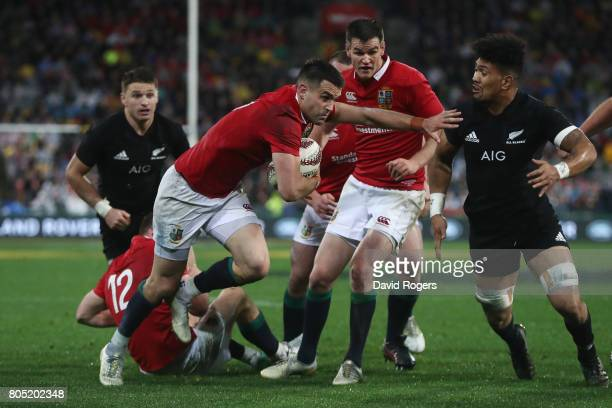 Conor Murray of the Lions hands off Ardie Savea of the All Blacks to score his team's second try during the second test match between the New Zealand...