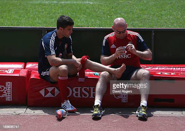 Conor Murray receives attention for blisters during the British and Irish Lions captain's run at the Aberdeen Sports Ground on May 31 2013 in Hong...