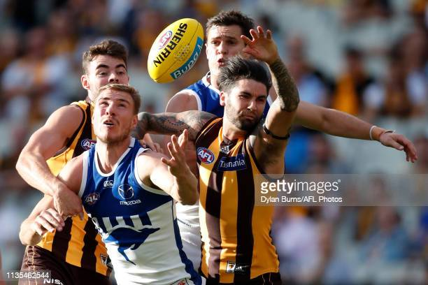 Conor Nash of the Hawks Ben McKay of the Kangaroos Chad Wingard of the Hawks Scott Thompson of the Kangaroos compete for the ball during the 2019 AFL...