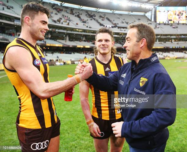 Conor Nash of the Hawks celebrates the win in his first match with Hawks head coach Alastair Clarkson in the round 21 AFL match between the Hawthorn...