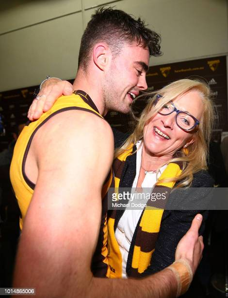 Conor Nash of the Hawks celebrates the win with his mother during the round 21 AFL match between the Hawthorn Hawks and the Geelong Cats at Melbourne...