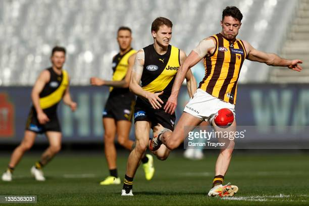 Conor Nash of the Hawks kicks the ball during the round 23 AFL match between Richmond Tigers and Hawthorn Hawks at Melbourne Cricket Ground on August...