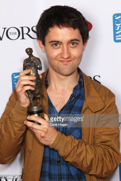 Conor O'Brien of Villagers poses with his Best Song Award in the press room at The Ivor Novello Awards 2011 at The Grosvenor House Hotel on May 19...