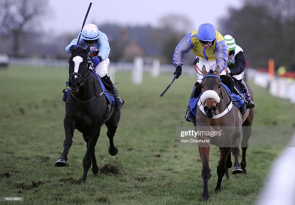 Conor O'Farrell riding Centasia (L) win The Wedding Receptions At Ludlow Standard Open National Hunt Falt Race from Sealous Scout (R) at Ludlow racecourse on January 30, 2013 in Ludlow, England.