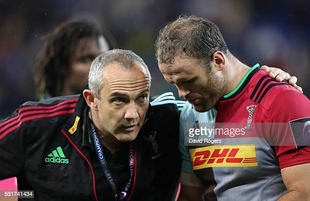 Conor O'Shea the Harlequins director of rugby consoles Jamie Roberts after their defeat during the European Rugby Challenge Cup Final match between...