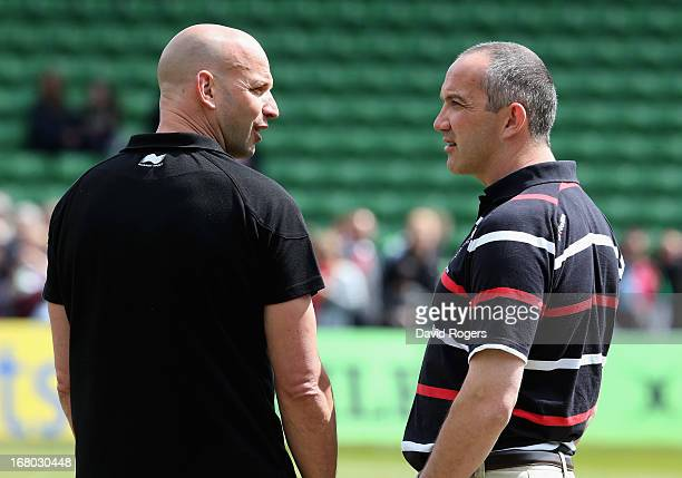 Conor O'Shea the Harlequins director of rugby talks to Jim Mallinder the Northampton director of rugby during the Aviva Premiership match between...
