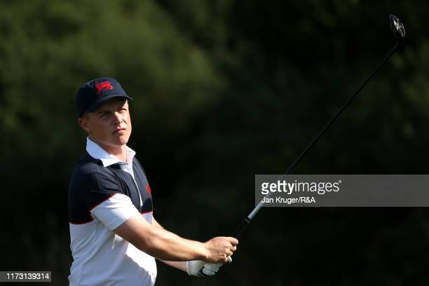 Conor Purcell of Great Britain and Ireland plays a shot on the third in the singles matches during Day 2 of the Walker Cup at Royal Liverpool Golf...