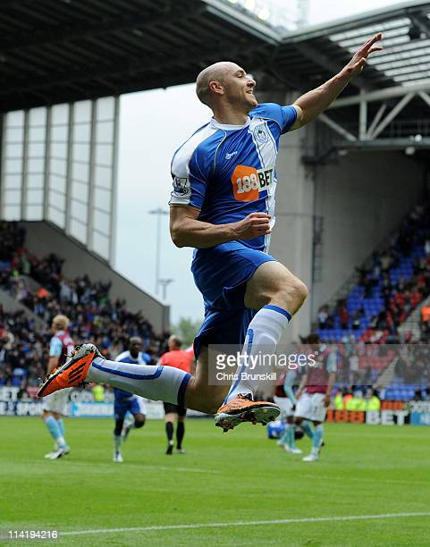 Conor Sammon of Wigan Athletic celebrates scoring his team's second goal during the Barclays Premier League match between Wigan Athletic and West Ham...