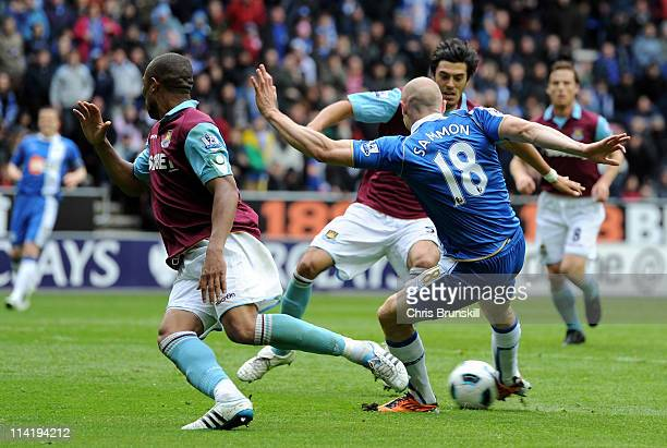 Conor Sammon of Wigan Athletic scores his team's second goal during the Barclays Premier League match between Wigan Athletic and West Ham United at...