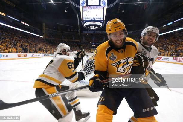 Conor Sheary and Sidney Crosby of the Pittsburgh Penguins defend Calle Jarnkrok of the Nashville Predators during the third period in Game Six of the...