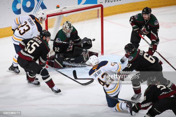 Conor Sheary of the Buffalo Sabres scores a power play goal past goaltender Antti Raanta of the Arizona Coyotes during the first period of the NHL...