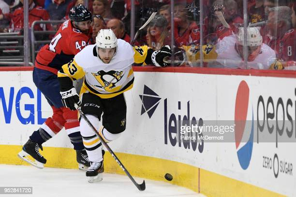 Conor Sheary of the Pittsburgh Penguins and Brooks Orpik of the Washington Capitals battles for the puck in the second period in Game Two of the...