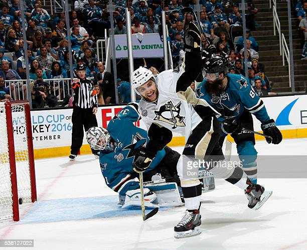 Conor Sheary of the Pittsburgh Penguins celebrates after the puck gets past Martin Jones and Brent Burns of the San Jose Sharks in Game Three of the...