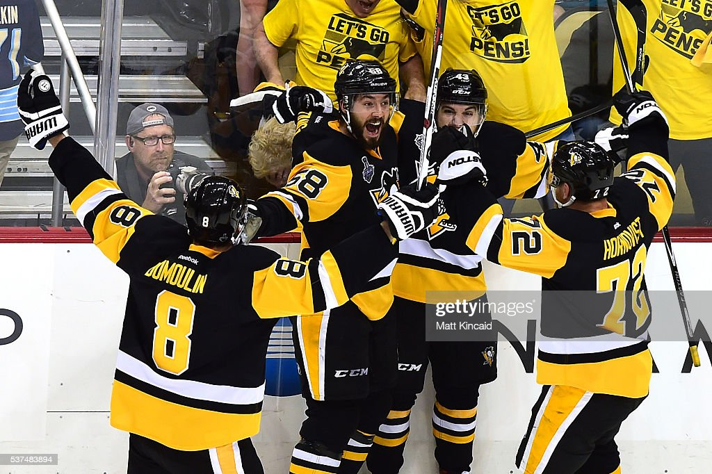 Conor Sheary #43 of the Pittsburgh Penguins celebrates with teammates after scoring the game-winning goal to defeat the San Jose Sharks 2-1 during overtime in Game Two of the 2016 NHL Stanley Cup Final at Consol Energy Center on June 1, 2016 in Pittsburgh, Pennsylvania.