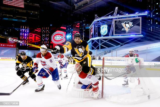 Conor Sheary of the Pittsburgh Penguins falls to the ice after colliding with goaltender Carey Price of the Montreal Canadiens drawing a penalty shot...