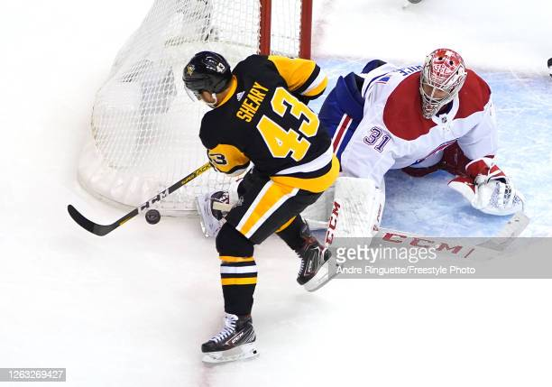 Conor Sheary of the Pittsburgh Penguins is blocked by Carey Price of the Montreal Canadiens in the third period during Game One of the Eastern...