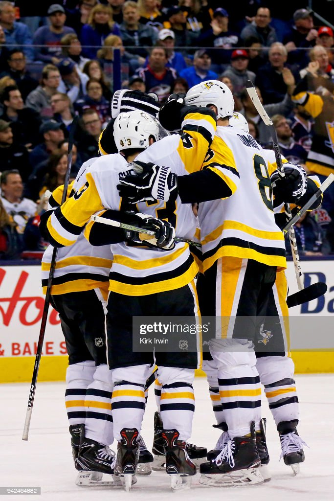 Conor Sheary #43 of the Pittsburgh Penguins is congratulated by his teammates after scoring the game tying goal during the third period of the game against the Columbus Blue Jackets on April 5, 2018 at Nationwide Arena in Columbus, Ohio. Pittsburgh defeated Columbus 5-4 in overtime.