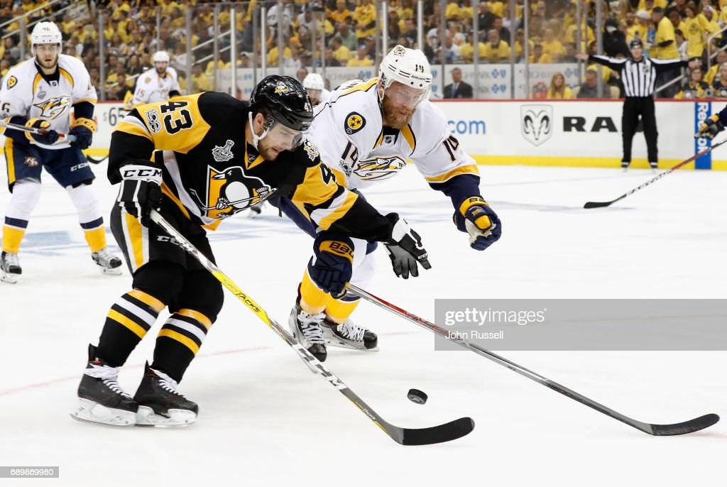 Conor Sheary #43 of the Pittsburgh Penguins is pressured by Mattias Ekholm #14 of the Nashville Predators during the first period of Game One of the 2017 NHL Stanley Cup Final at PPG Paints Arena on May 29, 2017 in Pittsburgh, Pennslyvannia.