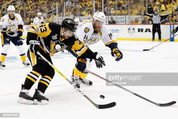Conor Sheary of the Pittsburgh Penguins is pressured by Mattias Ekholm of the Nashville Predators during the first period of Game One of the 2017 NHL...