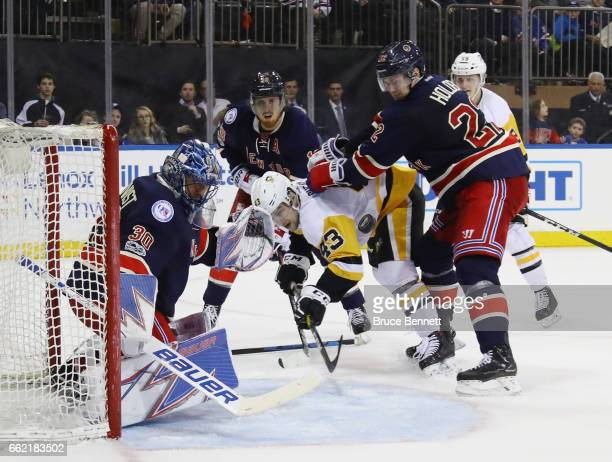 Conor Sheary of the Pittsburgh Penguins is stopped by the New York Rangers during the third period at Madison Square Garden on March 31 2017 in New...