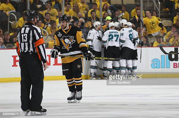 Conor Sheary of the Pittsburgh Penguins looks on as Paul Martin Joonas Donskoi Logan Couture Brent Burns and Joel Ward of the San Jose Sharks...