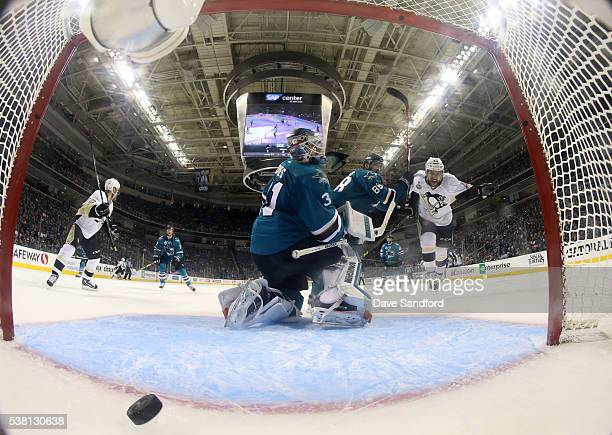 Conor Sheary of the Pittsburgh Penguins reacts after the puck went into the net past goaltender Martin Jones of the San Jose Sharks for a goal from...