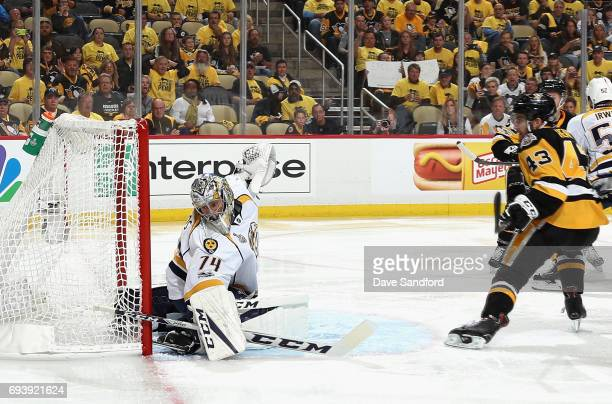 Conor Sheary of the Pittsburgh Penguins scores on goaltender Juuse Saros of the Nashville Predators during the second period of Game Five of the 2017...