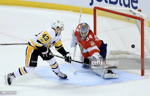 Conor Sheary of the Pittsburgh Penguins scores the game winning goal during a game against the Florida Panthers at BBT Center on October 20 2017 in...
