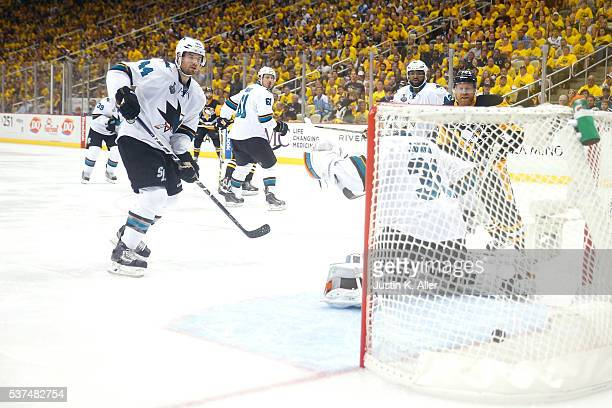 Conor Sheary of the Pittsburgh Penguins scores the gamewinning goal against Martin Jones of the San Jose Sharks to defeat the Sharks 21 in overtime...