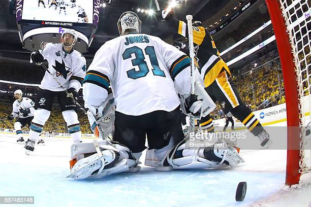 Conor Sheary of the Pittsburgh Penguins scores the gamewinning goal against Martin Jones of the San Jose Sharks to win 21 in overtime during Game Two...