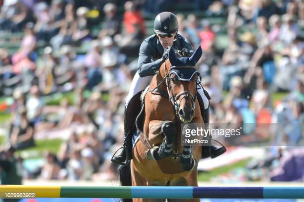 Conor Swail of Ireland riding GK Coco Chanel takes the second place during the SUNCOR Ennergy Winning Round individual jumping equestrian event on...