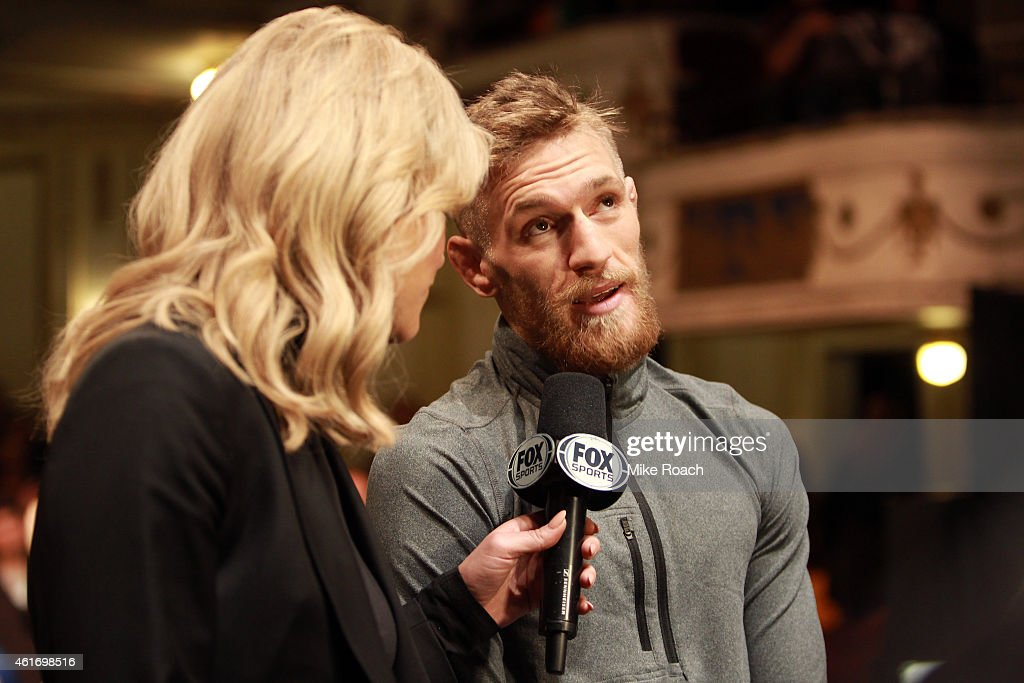 Conor 'The Notorious' McGregor of Ireland (R) is interviewed by FOX Sports broadcaster Charissa Thompson during the UFC Fight Night Boston weigh-in event at the Orpheum Theatre on January 17, 2015 in Boston, Massachusetts.