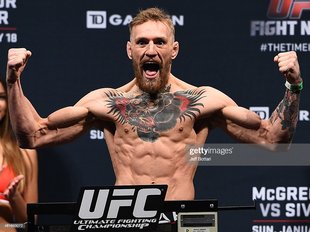 Conor 'The Notorious' McGregor of Ireland steps on the scale during the UFC Fight Night Boston weigh-in event at the Orpheum Theatre on January 17, 2015 in Boston, Massachusetts.