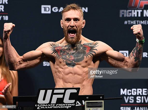 Conor 'The Notorious' McGregor of Ireland steps on the scale during the UFC Fight Night Boston weighin event at the Orpheum Theatre on January 17...